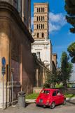 Old Fiat 500 car parked with Basilica dei Santi Bonifacio ed Alessio in the background, Rome, Lazio Photographic Print by Stefano Politi Markovina