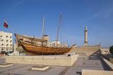 UAE, Dubai, Bur Dubai, Dubai Museum, exterior with traditional Dhow ship Reproduction photographique par Walter Bibikw