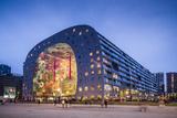 Netherlands, Rotterdam, Markthal foodhall, exterior, dusk Reproduction photographique par Walter Bibikw