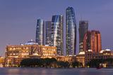 UAE, Abu Dhabi, Etihad Towers and Emirates Palace Hotel, dusk Reproduction photographique par Walter Bibikw
