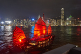 Traditional Chinese junk boat for tourists on Victoria Harbour illuminated at night, Hong Kong, Chi Photographic Print by Fraser Hall