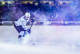 Ice Hockey Player in Action Kicking with Stick Fotografie-Druck von  dotshock