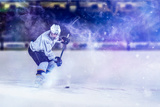 Ice Hockey Player in Action Kicking with Stick Photographic Print by  dotshock