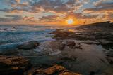 Fisherman fishing off rocks at sunrise, Queensland, Australia Valokuvavedos tekijänä Mark A Johnson