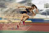 Woman Sprinter Leaving Starting Blocks Fotografie-Druck von Andrey Burmakin