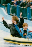 Princess Diana with Prince Harry on a Water Ride Foto von  Associated Newspapers