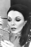 Joan Collins Applying Makeup Foto von  Associated Newspapers