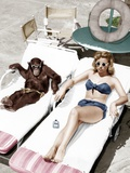 Chimpanzee and a Woman Sunbathing Foto