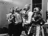 Kids Biting Apples on Strings at Halloween Foto