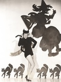 Woman in Cat Costume Posing Against Halloween Themed Wall Foto