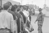 Young men who have been drafted wait in line to be processed into the US Army at Fort Jackson, SC Fotografisk tryk af Warren K. Leffler