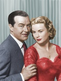 DIAL M FOR MURDER, 1954 directed by ALFRED HITCHCOCK Ray Milland and Grace Kelly (photo) Photo