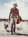 "ca., 1953 --- Actor John Wayne on the movie set of ""Hondo"" (Hondo, L'Homme du Desert), directed by  Photographie"