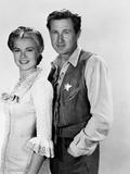 HIGH NOON, 1952 directed by FRED ZINNEMANN Grace Kelly and Lloyd Bridges (b/w photo) Photo