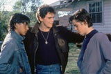 THE OUTSIDERS, 1982 directed by FRANCIS FORD COPPOLA Ralph Macchio, Matt Dillon andThomas C. Howell Foto