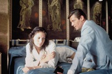 THE MAN WITH THE GOLDEN GUN, 1974 directed by GUY HAMILTON Maud Adams / Roger Moore (photo) Photo