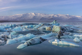 Calving icebergs in Jokulsarlon Glacier Lagoon in south Iceland Premium Photographic Print by Chuck Haney