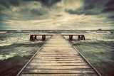 Old Wooden Jetty, Pier, during Storm on the Sea. Dramatic Sky with Dark, Heavy Clouds. Vintage Reproduction photographique par Michal Bednarek