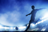 Football, Soccer Match. A Player Shooting on Goal. Lights on the Stadium at Night. Fotografie-Druck von Michal Bednarek