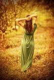 Sensual Nymph in Autumn Garden, Back Side of Sexy Girl Wearing Long Dress, Enjoying Autumnal Nature Impressão fotográfica por Anna Omelchenko