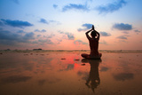 Silhouette Young Woman Practicing Yoga On The Beach At Sunset Prints by De Visu