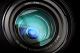 Close-Up View on Black Video Camera Lens Photographic Print by  Kokhanchikov