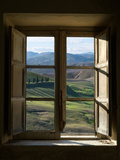 Outside View of Cypress Trees and Green Hills Through a Shabby Windows Lámina fotográfica por  ollirg