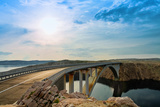 Bridge to the Pag Island with Sun and Clouds, Croatia Photographic Print by  Lamarinx