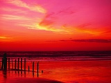 Surf Rolling onto Beach at Sunset Photographic Print by Mick Roessler