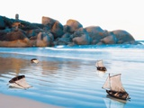 Toy Boats on Rocky Beach Photographic Print by Colin Anderson