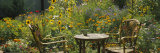 Empty Chairs and a Table in a Garden, Taos, New Mexico, USA Photographic Print by  Panoramic Images