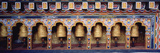 Prayer Wheels in a Temple, Chimi Lhakhang, Punakha, Bhutan Photographic Print