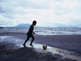 Boy Kicking Soccer Ball on Beach, Lake Nicaragua, Granada, Nicaragua Photographic Print by Eric Wheater