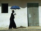 Man Walking with Umbrella, St. Louis, Senegal Photographic Print by Eric Wheater