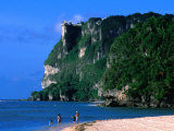 People in Water at Tumon Beach with Amantes (Two Lovers) Point Behind, Tumon, Guam Fotografisk tryk af John Elk III