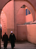 Two Men Walking along a Covered Street in the Medina, Marrakesh, Morocco Fotografisk tryk af John Elk III