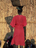 Back View of a Nuer Woman Carrying a Wicker Cradle or Crib on Her Head, Ilubador State, Ethiopia Reproduction photographique par Bruno Barbier