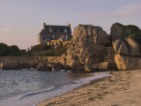 Beach House Built Behind Rocks, Tregastel, Cote De Granit Rose, Cotes d'Armor, Brittany, France Photographic Print by David Hughes
