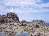 Lighthouse from the Causeway at Low Tide, Corbiere, St. Brelade, Jersey, Channel Islands Photographic Print by David Hunter