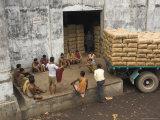 Warehouse Workers Having Rest Break at Carrit Moran & Company's Tea Warehouses at Kolkata Port Photographic Print by Eitan Simanor