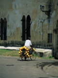 Coconut Seller Riding His Bicycle, Galle, Sri Lanka Photographic Print by Yadid Levy