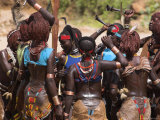 Women Sing and Dance Before the Bull Jumping, Turmi, Ethiopia Photographic Print by Jane Sweeney