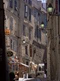 Narrow Street, Bonifacio, Corsica, France Photographic Print by Adam Woolfitt