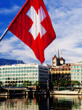 Swiss Flag on Mont Blanc Bridge with Quai General Guisan in Background, Geneva, Switzerland Photographic Print by Witold Skrypczak