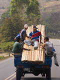 Men Riding on Back of Truck Carrying Timber, Near Esteli, Nicaragua Fotografisk tryk af Margie Politzer