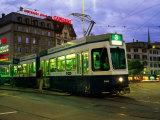 Stationary Tram on Central Sqaure at Dusk, Zurich, Switzerland Fotografie-Druck von Glenn Van Der Knijff