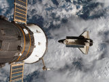 Space Shuttle Atlantis After It Undocked from the International Space Station on June 19, 2007 Photographic Print by  Stocktrek Images