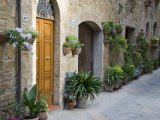 Flower Pots and Potted Plants Decorate a Narrow Street in Tuscan Village, Pienza, Italy Photographic Print by Dennis Flaherty