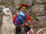 Woman with Llama, Boy, and Parrot, Sacsayhuaman Inca Ruins, Cusco, Peru Photographic Print by Dennis Kirkland
