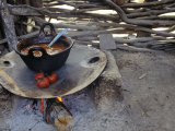 Beans and Tomoatoes Cook over a Fiel, Yucatan, Mexico Fotografisk tryk af Kenneth Garrett